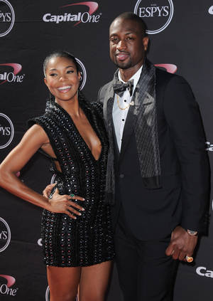 Photo - FILE - In this July 17, 2013, Actress Gabrielle Union, left, and Miami Heat's Dwyane Wade arrive at the ESPY Awards in Los Angeles. Wade and Union are engaged. The Miami Heat star proposed to his longtime girlfriend Saturday, Dec. 21, 2013, and the actress accepted. They announced the news through social media, around the same time as the two-time defending NBA champions were gathering for a team Christmas party. (Photo by Jordan Strauss/Invision/AP, File)