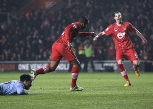 photo - Southampton's Jason Puncheon, center, celebrates his goal against Manchester City during their English Premier League soccer match at St Mary's stadium, Southampton, England, Saturday, Feb. 9, 2013. (AP Photo/Sang Tan)
