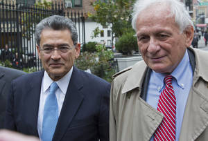 Photo -   Former Goldman Sachs and Procter & Gamble Co. board member Rajat Gupta, center, arrives outside federal court in New York Wednesday, Oct. 24, 2012. Gupta is to be sentenced after being found guilty insider trading by passing secrets between March 2007 and January 2009 to a billionaire hedge fund founder who used the information to make millions of dollars. At right is Gupta's attorney Gary Naftalis. (AP Photo/Craig Ruttle)
