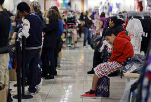photo - FILE - In this  Friday, Nov. 23, 2012, file photo, a teenage boy waits for his family to finish shopping at a J.C. Penney store in Las Vegas. Black Friday. Major retailers such a on Thursday, Nov. 29, 2012, reported weak sales in November as a strong start the holiday shopping season over the Thanksgiving weekend wasn't enough to fully offset a slow start to the month caused by Superstorm Sandy  (AP Photo/Julie Jacobson)