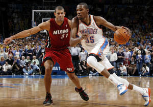 "Photo - Oklahoma City's Kevin Durant, right, drives the ball past Miami's Shane Battier at Chesapeake Energy Arena on Sunday. Battier said Sunday following the Thunder's 103-87 victory that signing with the Thunder last offseason ""was a very intriguing possibility for me.""Photo by Nate Billings, The Oklahoman"