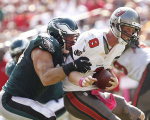 Photo - Philadelphia Eagles' Connor Barwin sacks Tampa Bay Buccaneers' quarterback Mike Glennon in the second half of an NFL football game Sunday, Oct. 13,  2013, in Tampa, Fla. (AP Photo/Philadelphia Inquirer, Ron Cortes) TV OUT MAGS OUT