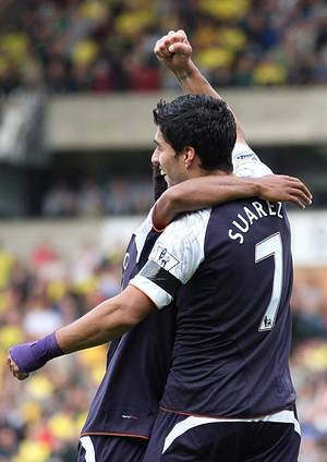 photo -   Liverpool's Luis Suarez celebrates scoring against Norwich City with teammate Raheem Sterling during the English Premier League soccer match at Carrow Road, Norwich, England, Saturday Sept. 29, 2012. Liverpool won the match 2-5. (AP Photo/PA, Chris Radburn) UNITED KINGDOM OUT NO SALES NO ARCHIVE