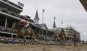 Photo - Joel Rosario rides Orb to victory during the 139th Kentucky Derby at Churchill Downs Saturday, May 4, 2013, in Louisville, Ky. (AP Photo/David J. Phillip)