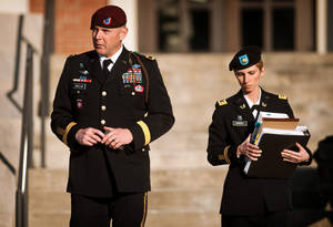 photo - Army Brig. Gen. Jeffrey A. Sinclair, left, leaves a Fort Bragg courthouse with a member of his defense team, Maj. Elizabeth Ramsey, Tuesday, Jan. 22, 2012, after he deferred entering a plea at his arraignment on charges of fraud, forcible sodomy, coercion and inappropriate relationships.  Sinclair, who served five combat tours, is headed to trial following a spate of highly publicized military sex scandals involving high-ranking officers that has triggered a review of ethics training across the service branches.    (AP Photo/The Fayetteville Observer, Andrew Craft)