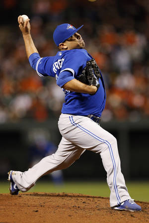 Photo -   Toronto Blue Jays starting pitcher Ricky Romero throws to the Baltimore Orioles in the second inning of the second baseball game of a doubleheader in Baltimore, Monday, Sept. 24, 2012. (AP Photo/Patrick Semansky)