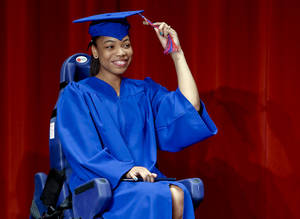 photo - John Marshall High School student Kristen Wilson moves her tassel to the left side while going through her special graduation ceremony at John Marshall High School on Tuesday, June 5, 2012, in Oklahoma City, Oklahoma. Wilson missed her graduation because she was in a car crash on the day of John Marshall's graduation. After undergoing weeks of physical therapy, Wilson was  strong enough to go through a special graduation ceremony held just for her.Photo by Chris Landsberger, The Oklahoma.