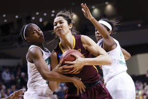Photo - Notre Dame guard Lindsay Allen, left, Arizona State center Joy Burke, center, and Notre Dame forward Ariel Braker, right, go after the rebound during the first half in a second-round game in the NCAA women's college basketball tournament in Toledo, Ohio, Monday, March 24, 2014. (AP Photo/Rick Osentoski)