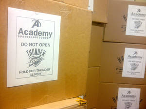 Photo - Boxes of Thunder gear await the outcome of tonight's game at Academy Sports + Outdoors. <strong> - PROVIDED</strong>