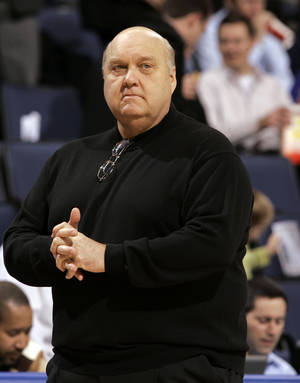 Photo - FILE - In this Jan. 14, 2009, file photo, Saint Louis coach Rick Majerus stands on the sidelines during the first half of an NCAA college basketball game against Massachusetts in St. Louis. Majerus, the jovial college basketball coach who led Utah to the 1998 NCAA final and had only one losing season in 25 years with four schools, died Saturday, Dec. 1, 2012. He was 64.  (AP Photo/Jeff Roberson, File)