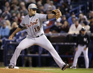 Photo - Detroit Tigers starting pitcher Anibal Sanchez (19) delivers in the first inning of a spring training baseball game against the New York Yankees in Tampa, Fla., Friday, March 7, 2014. (AP Photo/Kathy Willens)