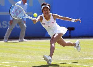 Photo - Japan's Kimiko Date-Krumm makes a return to Slovakia's Daniela Hantuchova during the Aegon Classic at Edgbaston Priory Club, Birmingham England Thursday June 12, 2014. (AP Photo/David Davies/PA) UNITED KINGDOM OUT