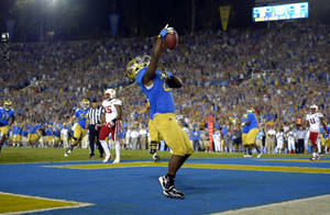 Photo -   UCLA running back Johnathan Franklin celebrates after scoring a touchdown during the second half of their NCAA football game against Nebraska, Saturday, Sept. 8, 2012, in Pasadena, Calif. UCLA won 36-30. (AP Photo/Mark J. Terrill)