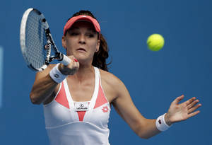 photo - Poland's Agnieszka Radwanska hits a forehand return to Britain's Heather Watson during their third round match at the Australian Open tennis championship in Melbourne, Australia, Friday, Jan. 18, 2013. (AP Photo/Andy Wong)