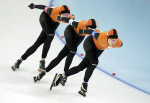 Photo - Speedskaters from the Netherlands, left to right, Jorien ter Mors, Marrit Leenstra and Ireen Wust compete in the women's speedskating team pursuit semifinals at the Adler Arena Skating Center at the 2014 Winter Olympics, Saturday, Feb. 22, 2014, in Sochi, Russia. (AP Photo/Matt Dunham)