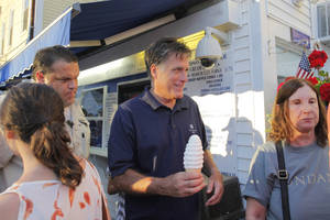 photo -   Republican presidential candidate Mitt Romney buys ice cream from Bailey's Bubble in Wolfeboro, N.H., Monday, July 2, 2012, as he continues his vacation from the campaign trail. (AP Photo/Charles Dharapak)