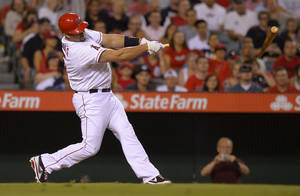 Photo - Los Angeles Angels' Albert Pujols breaks his bat as he grounds out during the seventh inning of their baseball game against the St. Louis Cardinals, Tuesday, July 2, 2013, in Anaheim, Calif. (AP Photo/Mark J. Terrill)