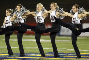 Photo - The Edmond Memorial pom squad performs during a high school football game between Edmond Memorial and Deer Creek at Wantland Stadium in Edmond. Photo by Nate Billings, The Oklahoman <strong>NATE BILLINGS - NATE BILLINGS</strong>