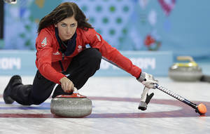Photo - Great Britain's skip Eve Muirhead delivers the rock during the women's curling competition against the United States at the 2014 Winter Olympics, Tuesday, Feb. 11, 2014, in Sochi, Russia. (AP Photo/Wong Maye-E)
