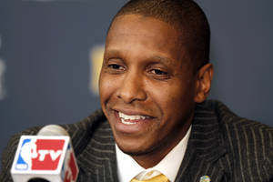 Photo - FILE - In this Feb. 22, 2011, file photo, Denver Nuggets executive vice president of basketball operations Masai Ujiri addresses the media about the trade of Carmelo Anthony and Chauncey Billups to the New York Knicks during an NBA basketball news conference in Denver. Ujiri was named the NBA's executive of the year on Thursday, May 9, 2013, a day after Karl was named the league's top coach. (AP Photo/Barry Gutierrez, File)