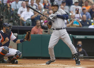 Photo - New York Yankees' Derek Jeter reacts after getting hit by a pitch in the first inning against the Houston Astros in a baseball game Tuesday, April 1, 2014, in Houston. The Astros won 6-2. (AP Photo/ The Courier, Jason Fochtman)