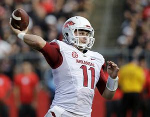 Photo - Arkansas quarterback AJ Derby throws a pass during the first half of an NCAA college football game against Rutgers in Piscataway, N.J., Saturday, Sept. 21, 2013. (AP Photo/Mel Evans)
