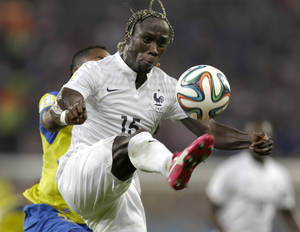 Photo - France's Bacary Sagna clears the ball ahead of Ecuador's Alex Ibarra during the group E World Cup soccer match between Ecuador and France at the Maracana Stadium in Rio de Janeiro, Brazil, Wednesday, June 25, 2014. (AP Photo/Natacha Pisarenko)