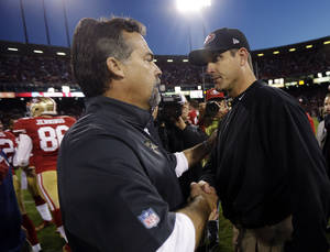 Photo -   St. Louis Rams head coach Jeff Fisher, left, shakes hands with San Francisco 49ers head coach Jim Harbaugh at the end of their NFL football game in San Francisco, Sunday, Nov. 11, 2012. San Francisco and St. Louis tied their game 24-24. (AP Photo/Marcio Jose Sanchez)
