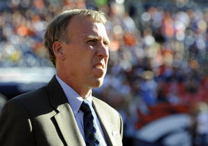 photo - FILE - In this Sept. 19, 2010, file photo, John Idzik, Seattle Seahawks vice president of football administration, looks on prior to an NFL football game against the Denver Broncos in Denver. The New York Jets hired Idzik on Friday, Jan. 18, 2013, to be their general manager, ending a search that included 10 candidates and lasted nearly three weeks. (AP Photo/Jack Dempsey, File)