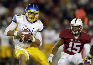 Photo -   San Jose State quarterback David Fales is chased by Stanford cornerback Usua Amanam (15) during the second half of an NCAA college football game in Stanford, Calif., Friday, Aug. 31, 2012. Stanford won, 20-17. (AP Photo/Marcio Jose Sanchez)