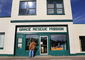 photo - Grace Rescue Mission in the Stockyards will serve a traditional Thanksgiving meal this year.  These photos show people taking advantage of the mission's lunch offering on Monday, Nov. 19, 2012.  Photo by Jim Beckel, The Oklahoman