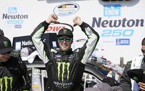 Photo - Sam Hornish Jr. celebrates in victory lane after winning the NASCAR Nationwide auto race, Sunday, May 18, 2014, at Iowa Speedway in Newton, Iowa. (AP Photo/Charlie Neibergall)