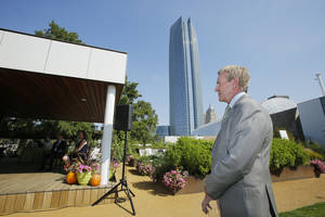 Photo - Fred Hall, with the Fred Jones Family Foundation, presented a check for $75,000 Friday to the Myriad Gardens Foundation during a short ceremony in the Myriad Gardens in Oklahoma City. Photo By Steve Gooch, The Oklahoman <strong>Steve Gooch</strong>