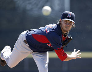 Photo - Boston Red Sox starting pitcher Clay Buchholz delivers a warm-up pitch before the start of a spring exhibition baseball game against the Toronto Blue Jays in Dunedin, Fla., Friday, March 14, 2014.  Buchholz allowed no runs on two hits with three strikeouts in four innings. (AP Photo/Kathy Willens)