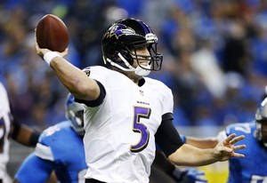 Photo - Baltimore Ravens quarterback Joe Flacco throws during the first quarter of an NFL football game against the Detroit Lions in Detroit, Monday, Dec. 16, 2013. (AP Photo/Rick Osentoski)