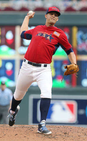 Photo - United States' pitcher Christian Binford throws a pitch during the third inning of the All-Star Futures baseball game against the World Team, Sunday, July 13, 2014, in Minneapolis. (AP Photo/Jim Mone)