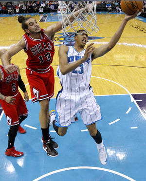 photo - New Orleans Hornets forward Anthony Davis (23) goes to the basket against Chicago Bulls center Joakim Noah (13) during the second half of an NBA basketball game in New Orleans, Tuesday, Feb. 19, 2013. The Bulls won 96-87. (AP Photo/Jonathan Bachman)