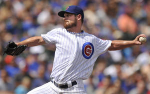 Photo - Chicago Cubs starter Travis Wood delivers a pitch during the first inning of a  baseball game against the Miami Marlins in Chicago, Monday, Sept. 2, 2013. (AP Photo/Paul Beaty)