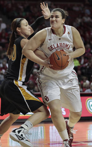 Photo - Oklahoma Sooners' Jelena Cerina (12) shoots against Missouri Tigers' Christine Flores (50) in the first half as the University of Oklahoma (OU) Sooners play the Missouri Tigers in women's college basketball at the Lloyd Noble Center on Saturday, Feb. 11, 2012, in Norman, Okla.   Photo by Steve Sisney, The Oklahoman