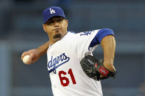 Photo - Los Angeles Dodgers starting pitcher Josh Beckett pitches against the Colorado Rockies in the first inning of a baseball game on Friday, April 25, 2014, in Los Angeles. (AP Photo/Alex Gallardo)