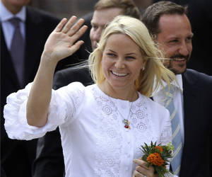 Photo - FILE- Norwegian Crown Pricess Mette-Marit and her husband Crown Prince Haakon Magnus, right, wave to the waiting crowd in Stralsund, northern Germany, in this file photo dated Saturday, June 12, 2010.  When friends of Norway's Crown Princess Mette-Marit couldn't travel to India to welcome their surrogate twins into the world, Crown Princess Mette-Marit stepped in and flew to India to look after the twins until the two fathers could fly out, according to Royal Court spokeswoman Marianne Hagen on Monday Dec. 3, 2012,  minding the couple's newly born children and being mistaken by hospital staff for a nanny.  The princess flew to Delhi on Oct. 23, 2012, after visa problems prevented the children's Norwegian parents from arriving at the hospital in time for the birth.(AP Photo/ddp/Michael Urban, File)