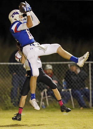 Photo - CHA's Colton Lindsey (16) intercepts a pass intended for Luther's Collin Bailey (1) during a Luther High School at Christian Heritage Academy football game in Oklahoma City, Thursday, Oct. 17, 2013. Photo by Nate Billings, The Oklahoman
