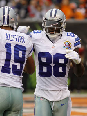 photo - Dallas Cowboys wide receiver Dez Bryant (88) is congratulated by wide receiver Miles Austin (19) after Bryant scored on a 27-yard pass reception in the second half of an NFL football game against the Cincinnati Bengals, Sunday, Dec. 9, 2012, in Cincinnati. Dallas won 20-19. (AP Photo/Tom Uhlman)