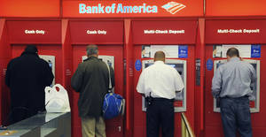 Photo - FILE - In this file photo taken Oct. 16, 2009, customers use ATM machines at a Bank of America branch office in Boston. The FDIC reported that the U.S. banking industry earned $37.2 billion in the first quarter of 2014, down from $40.3 billion in the same period in 2013. (AP Photo/Lisa Poole, File)