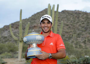 Photo - Jason Day, of Australia, poses with the trophy after winning his championship match against Victor Dubuisson, of France, during the Match Play Championship golf tournament on Sunday, Feb. 23, 2014, in Marana, Ariz. (AP Photo/Ted S. Warren)