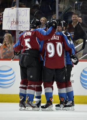 Photo - Colorado Avalanche defenseman Nate Guenin (5) and Gabriel Landeskog (92) celebrate a Ryan O'Reilly (90) goal against the Philadelphia Flyers during the second period of an NHL hockey game on Thursday, Jan. 2, 2014, in Denver. (AP Photo/Jack Dempsey)
