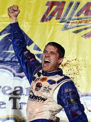 Photo - David Ragan celebrates after winning the NASCAR Sprint Cup Series Aaron's 499 auto race at Talladega Superspeedway in Talladega, Ala., Sunday, May 5, 2013. (AP Photo/Rainier Ehrhardt)
