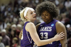 Photo - James Madison's Nikki Newman hugs teammate Lauren Okafor (33) after the team's 85-69 loss toTexas A&M in an NCAA women's college basketball tournament second-round game, Tuesday, March 25, 2014, in College Station, Texas. (AP Photo/Patric Schneider)