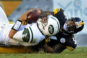 Photo -   Pittsburgh Steelers outside linebacker LaMarr Woodley (56) sacks New York Jets quarterback Mark Sanchez (6) in the third quarter of an NFL football game, Sunday, Sept. 16, 2012, in Pittsburgh. The Steelers won 27-10. (AP Photo/Don Wright)