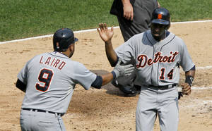 Photo -   Detroit Tigers' Gerald Laird (9) greets Austin Jackson at home after the pair scored on a single by Delmon Young, off a pitch by Chicago White Sox's Jose Quintana, during the third inning of a baseball game, Monday, Sept. 17, 2012, in Chicago. (AP Photo/Charles Rex Arbogast)